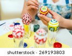 woman paints the easter eggs... | Shutterstock . vector #269193803