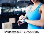 woman using activity tracker at ... | Shutterstock . vector #269206187