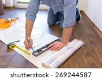 handyman measuring wallpaper to ... | Shutterstock . vector #269244587