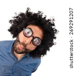 Small photo of WOW, funny young man with unkempt hair and thick glasses on white background.