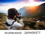 girl photographing the sunset...   Shutterstock . vector #269409377