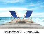 blue chairs and gray pier of...