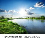 Sun Over Calm River In The...