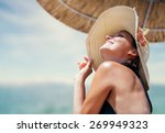 Woman In Big Straw Hat Enjoyed...