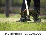 The Gardener Cutting Grass By...