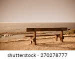 Wooden Bench On The Beach...