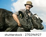 farmer and cows | Shutterstock . vector #270296927