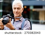 senior man with camera in city | Shutterstock . vector #270382043
