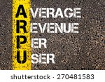 Small photo of Business Acronym ARPU - Average revenue per user. Yellow paint line on the road against asphalt background. Conceptual image