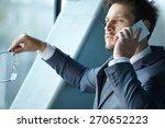 businessman talking on mobile... | Shutterstock . vector #270652223