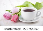 A Cup Of Tea With Tulips On A...