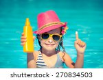 Happy Child Holding Sunscreen...