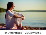 tranquil young woman sitting on ... | Shutterstock . vector #270894053