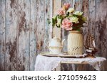 Porcelain Teapot And Cup On A...