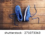 Pair Of Blue Running Shoes Lai...