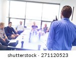 Small photo of Business man making a presentation at office. Business executive delivering a presentation to his colleagues during meeting or in-house business training, explaining business plans to his employees.