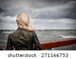 blond girl looking at stormy... | Shutterstock . vector #271166753