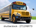 School Bus On Blacktop With...