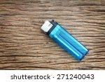 blue lighter on the wooden floor   Shutterstock . vector #271240043