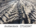 Excavator tracks on a building site - stock photo