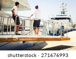Yacht Crew On The Boat Ramp At...