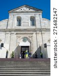 Small photo of Torino, Italy - April 21, 2015: Security people at the entrance of the Cathedral of Turin, Italy, ready for 2015 Holy Shroud Exhibition. Wide angle view from below.