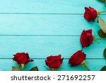 frame of red roses on blue... | Shutterstock . vector #271692257