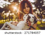 Stock photo young woman holding her dog in nature 271784057
