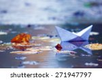 Paper Boat In A Pool With...