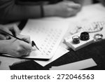 woman writing calligraphic... | Shutterstock . vector #272046563