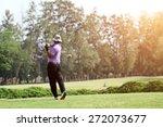 blurred golfers hit sweeping