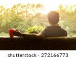 young man relaxing in a garden... | Shutterstock . vector #272166773