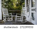 Two Old Rocking Chairs On The...