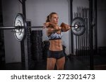 fit girl performing front squat. | Shutterstock . vector #272301473