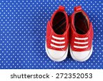 Baby Shoes On Blue Cloth...