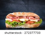 big ciabatta sandwich with meat ... | Shutterstock . vector #272377733