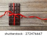 dark chocolate bar with red bow ... | Shutterstock . vector #272476667