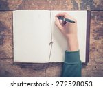 a male hand is writing in a big ... | Shutterstock . vector #272598053