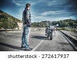 Biker Standing Next To A...
