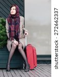 classy woman with suitcase is... | Shutterstock . vector #272662337