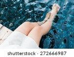 young women legs in the pool | Shutterstock . vector #272666987