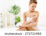 beautiful young woman applying... | Shutterstock . vector #272721983