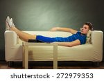 young man relaxing on couch ... | Shutterstock . vector #272979353