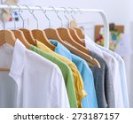 clothes hang on a shelf in ...   Shutterstock . vector #273187157