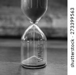Small photo of Vintage 15 minutes sandglass in black and white style