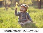 cute baby in knitwears playing... | Shutterstock . vector #273695057