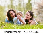 young family together in grass...   Shutterstock . vector #273773633