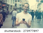 smiling man with mobile phone... | Shutterstock . vector #273977897