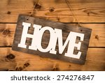 sign home on the wooden wall.  | Shutterstock . vector #274276847