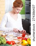 smiling young woman cutting... | Shutterstock . vector #274386437